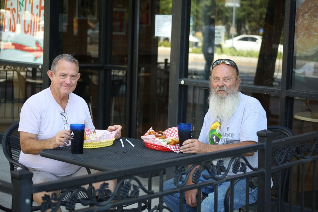 Homer, left, and Tad discuss Wyoming high school football over lunch.